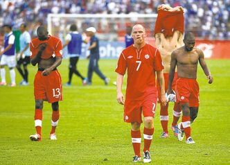 Esteban Felix / the associated press Canada's Iain Hume (7) and teammates exit the pitch after suffering a humiliating defeat in their 2014 World Cup qualifying soccer match against Honduras in San Pedro Sula, Honduras, Tuesday.