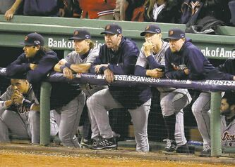 Some disconsolate Detroit Tigers watch their season ebb away late in the ninth inning of Game 6 Saturday night.