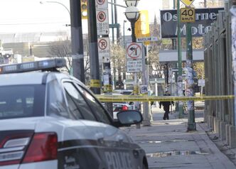 Police at a taped-off scene in Osborne Village Thursday morning.