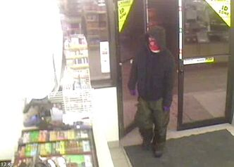 Picture from video surveillance shows the robber entering the store.