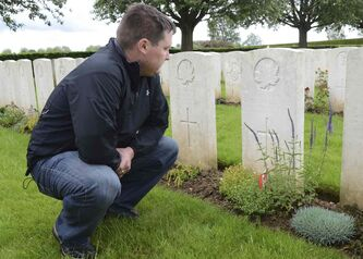 Sgt. Peter Montgomery, a serving member of the Royal Winnipeg Rifles, reflects at the grave of a relative, Pte. Phillipe Alfred Bieler, who was killed in 1917 at age 19.