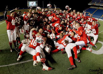 The Kelvin Clippers celebrate a win over the Grant Park Pirates at Canad Inns Stadium on Nov. 9.