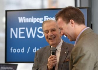 Former CTV National News anchor Lloyd Robertson, left, shares a laugh with Winnipeg Free Press reporter Geoff Kirybson at the Winnipeg Free Press News Café Tuesday afternoon during a promotional tour for his new book, The Kind Of Life It's Been.