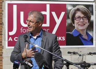 Mayoral candidate Gord Steeves stages an announcement on Portage Avenue near Judy Wasylycia-Leis' campaign headquarters Tuesday.
