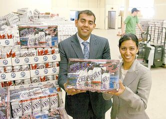 Ravinder Minhas and his sister Manjit Minhas at their warehouse in Regina.