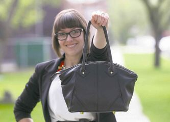 PHOTOS BY JOE BRYKSA / WINNIPEG FREE PRESS Monica Jones shows off a Barbara & Cecile handbag.