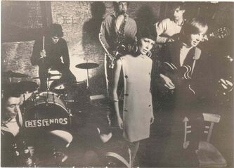 The Crescendos � drummer Vance Masters, singer/sax player Glenn MacRae, guitarist Terry Loeb (rear) and Liverpudlian Stuart McKernan, who replaced Denis Penner on bass � with a model at the Blue Angel nightclub.
