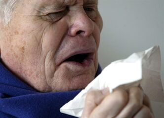 An elderly patient sneezes into a tissue on Friday, January 14, 2005 in Berlin, Germany. If you've been sick already this winter, it likely wasn't with influenza - which means, unfortunately that there's still time to catch flu too. THE CANADIAN PRESS/AP-Roberto Pfeil