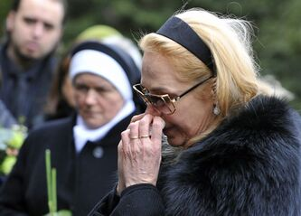 Dagmar Havlova, the widow of Czech President Vaclav Havel, wipes her nose in the touching moment during burying the urn with the Havel's ashes to the family tomb at the Vinohrady Cemetery in Prague Wednesday, Jan. 4, 2012. Vaclav Havel died Dec. 18, 2011 at age 75. (AP Photo/CTK, Roman Vondrous) SLOVAKIA OUT