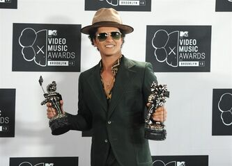 "FILE - In this Aug. 25, 2013 file photo, Bruno Mars poses backstage with the award for Best Male Video for ""Locked Out of Heaven"" at the MTV Video Music Awards at the Barclays Center in the Brooklyn borough of New York. Mars announced Saturday, Jan. 11, 20-14 that the Red Hot Chili Peppers will join him as part of his halftime show at the Super Bowl next month. (Photo by Evan Agostini/Invision/AP)"