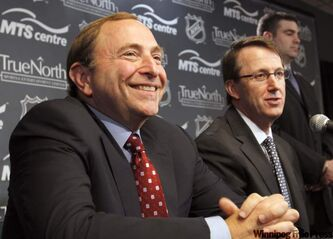 NHL Comissioner Gary Bettman (left) and True North's Mark Chipman at the press conference where they announced the return of the  NHL to Winnipeg.