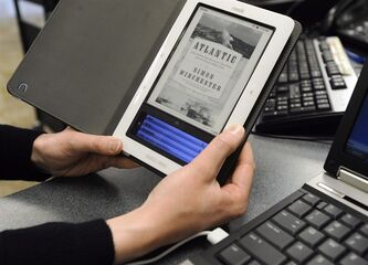 In this Feb. 4, 2011 photo, Heather Stephenson, a librarian at the Siouxland Library main branch, demonstrates how to download a book. THE CANADIAN PRESS/AP,The Argus Leader, Emily Spartz
