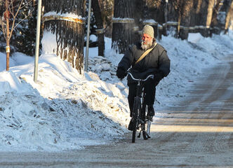 A cyclist makes his way along Arlington Street on Sunday morning while temperatures hovered around -37 C, with a wind chill of -51.