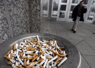 Cigarette butts fill the ash can at the Transportation Building at the State Capitol complex Thursday, Feb. 7, 2013 in St. Paul, Minn. A new study suggests that ex-smokers can gain a health status similar to those of people their own age who never smoked — but the process takes time. THE CANADIAN PRESS/AP-Jim Mone
