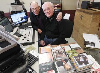 Making radio waves: CJNU manager Bill Stewart, left, visits disc jockey Ernie Nairn at the station's temporary home in the Khartum Shrine Centre.