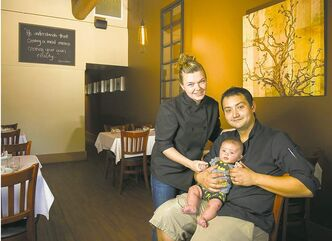 Kristen Chemerika-Lew and Kyle Lew with their three-month-old son Charlie. The couple just opened a new bistro in River Heights called Chew.