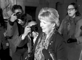 Sen. Pamela Wallin gets media attention as she arrives at the Senate Wednesday. Inside, she accused the Conservative government of trying to smear her.