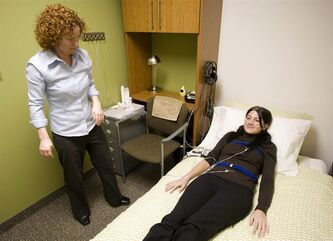 Colleen Carney, associate professor and Director of the Sleep and Depression Laboratory at Ryerson University in Toronto monitors psychology student Molly Atwood in Toronto, Ont. Monday, February 8, 2010. For those who face difficulties with falling asleep or catching quality zzz's, the path toward's a good night's rest begins long before their head hits the pillow.THE CANADIAN PRESS/Darren Calabrese