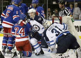 New York Rangers' Dan Girardi (5) congratulates teammate Ryan Callahan (24) after Callahan scored on Winnipeg Jets goalie Ondrej Pavelec in the second period of an NHL game at Madison Square Garden in New York Monday. Jets defenceman Jacob Trouba (8) watches the replay onthe scoreboard.