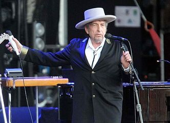 "This July 22, 2012 file photo shows U.S. singer-songwriter Bob Dylan performing on at ""Les Vieilles Charrues"" Festival in Carhaix, western France.  if his Chrysler ad makes him a sellout, he sold out long ago."