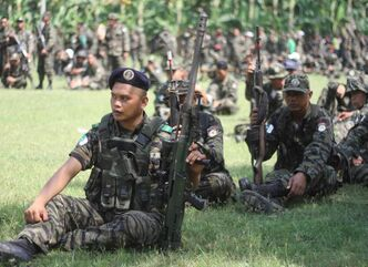 Members of the Moro Islamic Liberation Front gather at their stronghold in the southern Philippines to coincide with the tentative peace-signing agreement between the government and the MILF.
