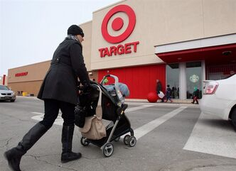 Customers enter the new Target store in in Guelph, Ont. on March 5, 2013. THE CANADIAN PRESS/Dave Chidley