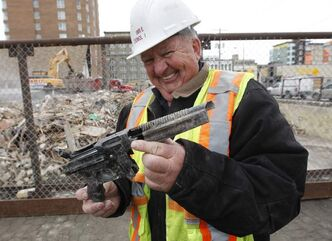 Wayne Imrie shows toy gun.