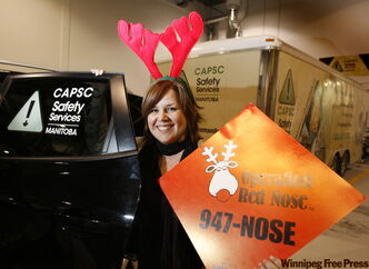 Operation Red Nose provincial co-ordinator Anita Zubricki shows the number to call for a ride.