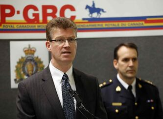"For the first time in North America, The Hells  Angels Motorcycle Club  has been listed as a criminal organization eliminating days of court time normally used to establish this designation. Justice Minister Andrew Swan (left) with Assistant Commissioner Kevin Brosseau, commanding officer, RCMP ""D"" Division at the press conference."