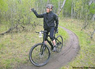 Lindsay Gauld rides the Bur Oak mountain bike trail at Birds Hill Park.