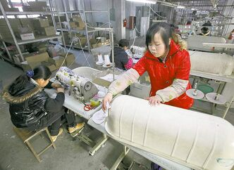 Chinese women work in a garment factory in Guangdong province.