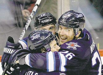Blake Wheeler (26) (right) is going to Germany.