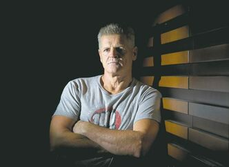 Former NHL tough guy Chris Nilan stands for a portrait while promoting the documentary