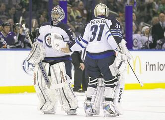 Jets goalie Al Montoya (left) replaces Ondrej Pavelec during the second period in Tampa Friday night. Pavelec had just surrendered his fifth goal in 14 shots.