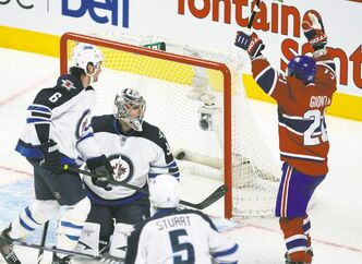 Montreal's Brian Gionta celebrates his goal over Jets goalie Ondrej Pavelec during second-period NHL action at the Bell Centre.