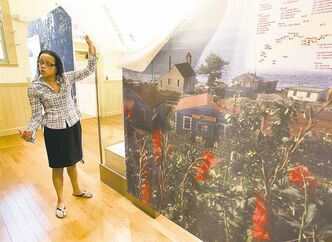 Tracey McCallum displays a mural at the Africville Heritage Trust Museum in Halifax.