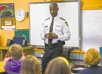 Winnipeg Police Service Chief Devon Clunis speaks to Brock Corydon School students on May 7.