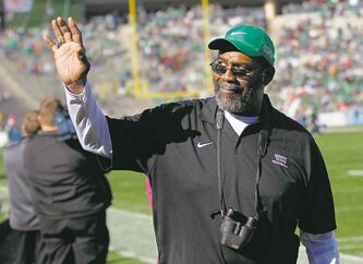 FILE - In this Jan. 1, 2014 file photo, North Texas alumni and former Pittsburgh Steeler defensive tackle Joe Greene waves towards the stands during the second half of the Heart of Dallas NCAA college football game against UNLV in Dallas. Joe Greene�s No. 75 now belongs to the ages. The Steelers announced Wednesday, July 30, 2014, the team will retire the Hall of Fame defensive end�s number during a game against the Baltimore Ravens on Nov. 2. (AP Photo/Mike Stone, File)