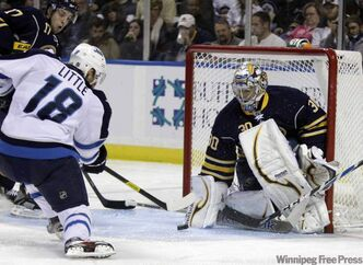 Buffalo Sabres goalie Ryan Miller makes a save on a shot by the Jets' Bryan Little (18) during the second period of their game in Buffalo, N.Y., on Tuesday.