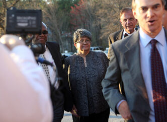 Former Atlanta Public Schools Superintendent Beverly Hall arrives at the Fulton County Jail on Tuesday in Atlanta, Georgia. More than a dozen of the 35 educators indicted in the Atlanta Public Schools cheating scandal turned themselves in to authorities.