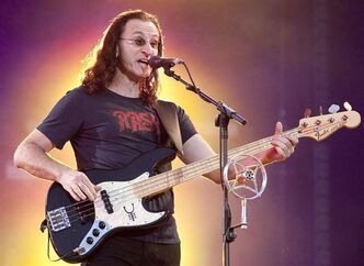Geddy Lee of Rush performs in front of a crowd of close to 100,000 fans Thursday, July 15, 2010 as part of the Quebec Summer Festival in Quebec City. Lee will throw out the ceremonial first pitch when the Toronto Blue Jays open their 37th regular season on Tuesday night against the Cleveland Indians.THE CANADIAN PRESS/Jacques Boissinot