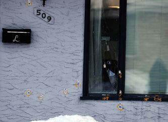 Winnipeg police mark bullet holes in a house in the 500 block of Seven Oaks Avenue which, for the second morning in a row, was shot at, with bullets penetrating the front wall and picture window.
