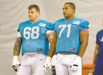Lynne Sladky / The Associated Press ArchivesMiami Dolphins guard Richie Incognito (68) and tackle Jonathan Martin on the field during a practice in Davie, Fla. Ignito is accused of threatening and harassing Martin.