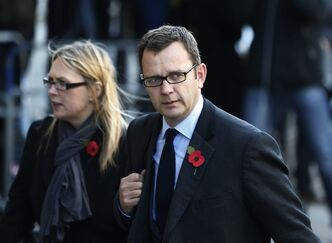 Former News of the World editor Andy Coulson, right, arrives at The Old Bailey law court in London, Monday, Oct. 28, 2013. Former News of the World national newspaper editors Rebekah Brooks and Andy Coulson are due to go on trial Monday along with several others, on charges of hacking phones and bribing officials while at the now closed tabloid paper. (AP Photo/Lefteris Pitarakis)
