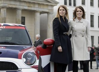 The members of the British royal family, Princess Beatrice of York, left, and Princess Eugenie of York, right, pose for the media during a promotion event for the Great Britain MINI Tour 2013 at the Brandenburg Gate in Berlin, Germany, Thursday, Jan. 17, 2013. It was meant to be a Mini adventure that nearly became a major embarrassment. Two British royals on a mission to promote their country broke German road rules by running a red light near Berlin's iconic Brandenburg Gate. With photographers and police in tow, Princess Eugenie and her older sister Princess Beatrice then took a swift right into the safety of the British embassy compound. At least the 22 and 24-year-old sisters didn't have to decide which side of the road to drive on. The entire 500-meter (550-yard) staged tour was along one-way streets (AP Photo/Michael Sohn)