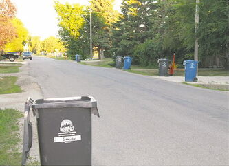 One side of Glenway Avenue is in the City of Winnipeg (note the city's garbage and recycling bins) while the other is in East St. Paul.