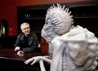 "Canadian filmmaker David Cronenberg sits with a Mugwump at the interzone bar from ""Naked Lunch"" while touring the exhibition ""David Cronenberg: Evolution"" in Toronto on Tuesday October 29, 2013. THE CANADIAN PRESS/Frank Gunn"