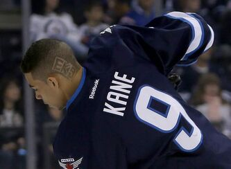 Winnipeg Jets' Evander Kane (9) displays his personalized hairdo during warmup as the Jets prepare to face the Philadelphia Flyers at MTS Centre in Winnipeg, Saturday.