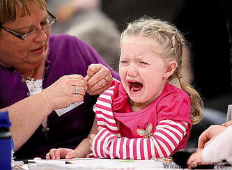 Elizabeth Little, 3, cries after her flu shot in Brandon.