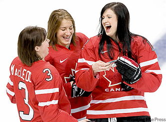Canada's Carla MacLeod, left, Colleen Sostorics, centre, and Meaghan Mikkelson laugh it up Tuesday.